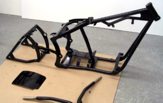 black bike frame with handlbars